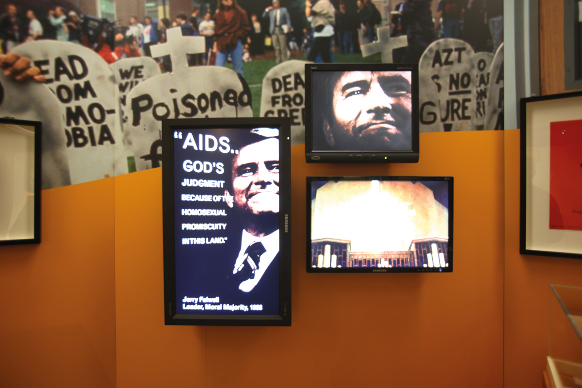 Multimedia installation in the gallery, showing homophobic quotes from politicians and public figures  alongside the rising death toll caused by AIDS. Courtesy of the National Library of Medicine.
